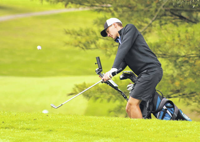 Gallia Academy sophomore Beau Johnson hits a chip shot onto the ninth green during the Division II sectional tournament held on Sept. 29 at the Elks Country Club in McDermott, Ohio.