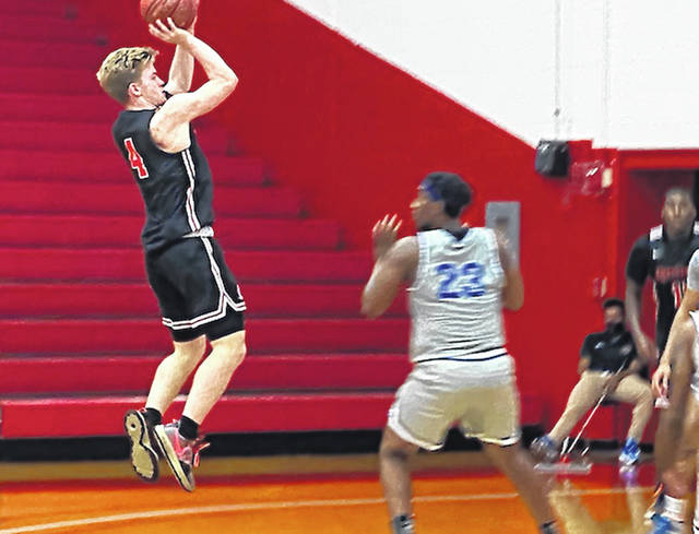 Rio Grande's Andrew Shull puts up two of his 21 points in the RedStorm's 98-85 win over Great Lakes Christian in the Bevo Francis Classic, Friday night, at the Newt Oliver Arena.