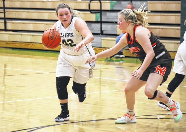 EHS sophomore Ella Carleton (42) drives past a NYHS defender, during the Lady Buckeyes' 45-30 victory on Monday in Tuppers Plains, Ohio.