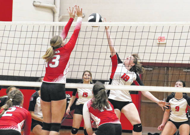 Point Pleasant junior Addy Cottrill (18) tips a free ball over a Wahama blocker during an Oct. 6 volleyball match in Point Pleasant, W.Va.