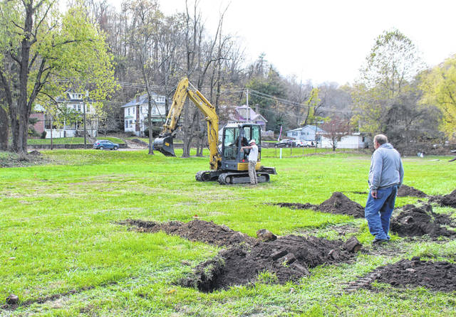 Pomeroy Mayor Don Anderson and village workers were at the park on Mechanic Street Thursday afternoon preparing the area for apple tree planting on Saturday.
