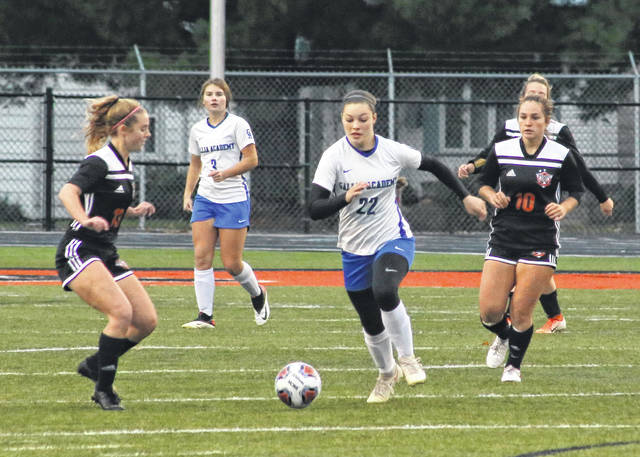 Gallia Academy junior Preslee Reed (22) tracks down a loose ball during the first half of a Division II sectional tournament game on Oct. 20 against Waverly at Raidiger Field in Waverly, Ohio.