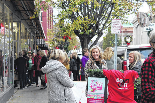 "Pictured are shoppers in downtown Point Pleasant at last year's Sugar Plum Stroll. This year, Main Street Merchants are hosting ""Christmas on Main"" on Dec. 5 and will also be celebrating Small Business Saturday this weekend, as small businesses across the country welcome holiday shoppers. (OVP File Photo)"