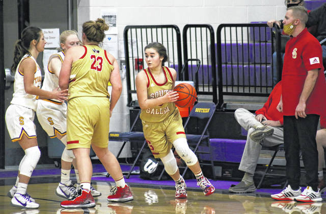 South Gallia's Tori Triplett runs off of a screen set by Ryleigh Halley (23), during the Lady Rebels' 53-26 victory on Wednesday in Racine, Ohio.