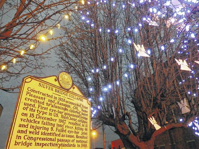 Pictured from the inaugural year of the annual Silver Bridge Memorial Ceremony in 2015, are the lighted trees and the Silver Bridge plaque at Sixth and Main streets in downtown Point Pleasant, W.Va. (OVP File Photo)