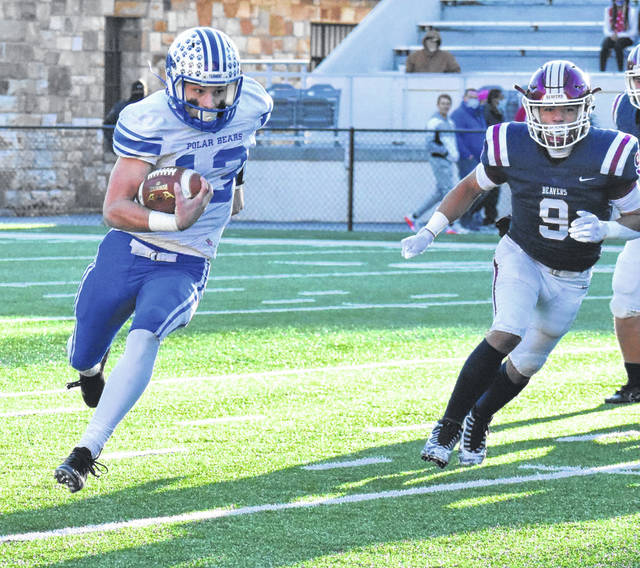 Fairmont Senior's Gage Michael runs upfield against Bluefield during a Class AA state semifinal game at Mitchell Stadium.