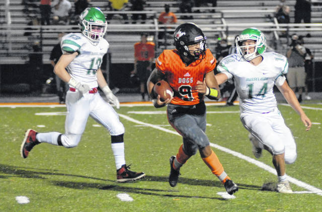 Carl Lee award winner Anthony Smith of Martinsburg tries to elude a pair of would-be tacklers after catching a pass during a game this past season against Musselman.