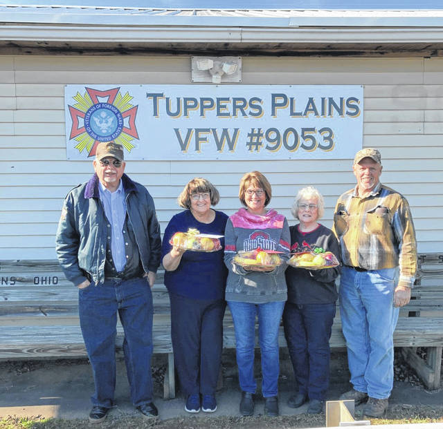 VFW Post 9053 in Tuppers Plains recently distributed fruit baskets to local veterans and widows. Members of the VFW and VFW Auxiliary are pictured with some of the fruit baskets. The VFW and the Auxiliary also volunteered to assist with the unloading of wreaths for the Wreaths Across America event to take place on Saturday, Dec. 19 at noon and cemeteries in the area including Meigs Memory Gardens. Racine American Legion and Pomeroy American Legion are also taking part in the event.