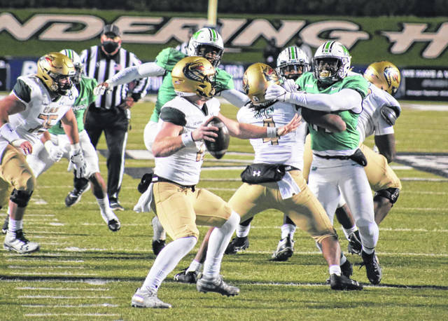 Marshall linebacker Abraham Beauplan, right, applies pressure to UAB quarterback Tyler Johnston III during the first half of Friday night's Conference USA championship game at Joan C. Edwards Stadium in Huntington, W.Va.