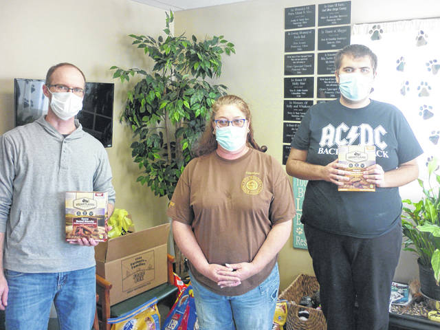 Carleton School's Transition Classroom delivers the donations gathered during their October food/supply drive for the Meigs County Canine Rescue and Adoption Center. Pictured are Ben Stairs, Instructor, Delani Cummins, Assistant Dog Warden, and Wyatt Shope, Student Volunteer.