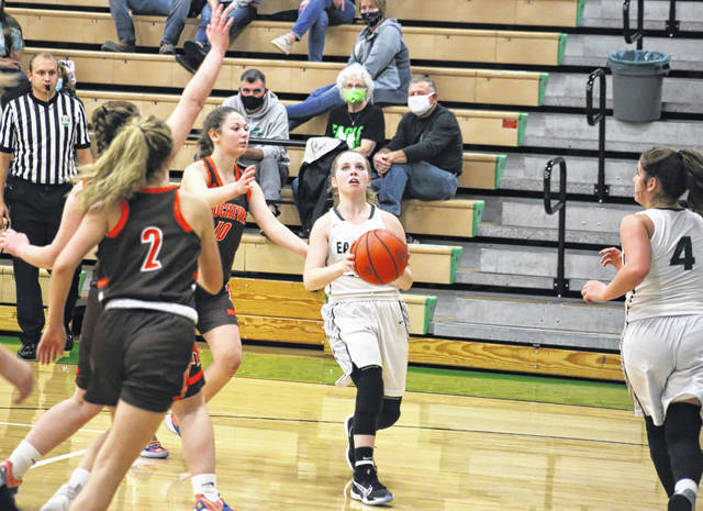 Eastern sophomore Jennifer Parker (center) goes up for a shot during the second half of the Lady Eagles' home-opening bout against Nelsonville-York on Nov. 23 in Tuppers Plains, Ohio.