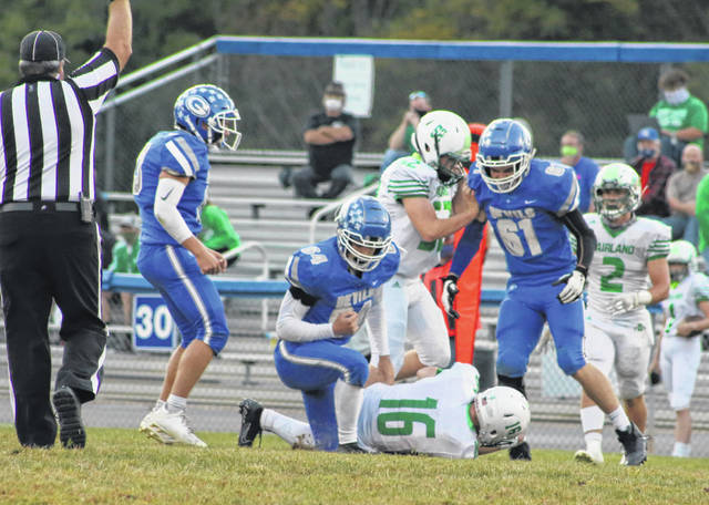Gallia Academy junior Brayden Easton (64) hovers over a Fairland player after a tackle during a Sept. 25 football game at Memorial Field in Gallipolis, Ohio.