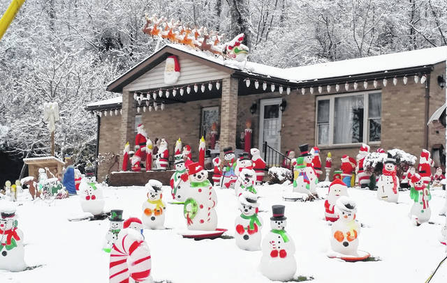 Snow surrounds some of the blow molds at the Parsons Christmas Display.