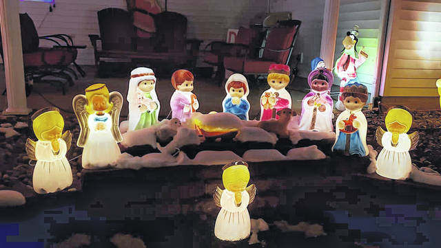 A blow mold nativity is among the display.
