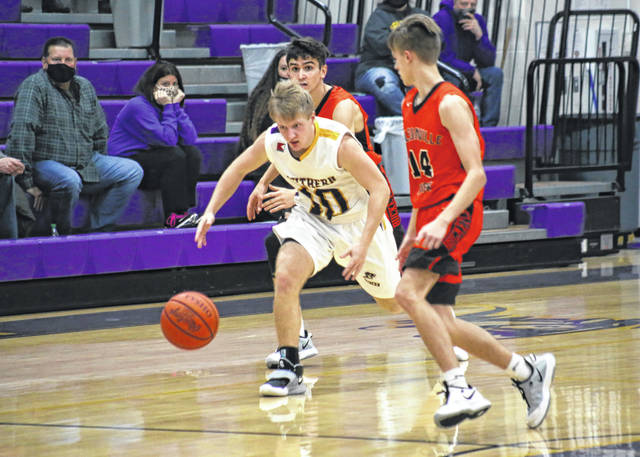 Southern senior Ryan Laudermilt (10) steals the ball and starts a fast break, during the Tornadoes' 65-60 loss to Nelsonville-York on Friday in Racine, Ohio.