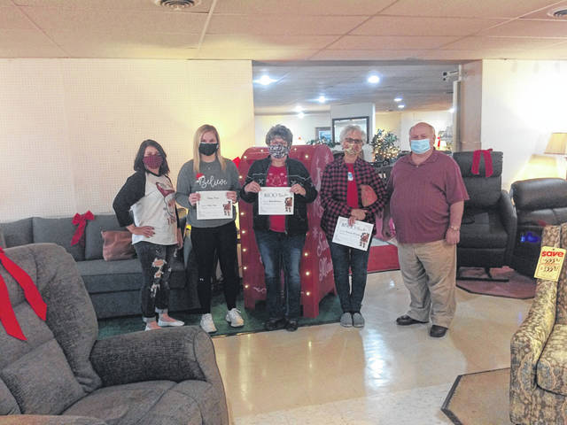 Merchant representatives along with winners of the gift certificates from the Christmas on Main shopping event are pictured, from left, Lindsey DeWeese owner M & Z Boutique with $250 gift certificate winner Kelsey Price, $100 gift certificate winner Wanda Watterson, $500 gift certificate winner Arminta McGraw, and Stan Bordman from Bordman Furniture.