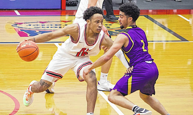 Rio Grande's Kam Harris tries to work past Carlow's Swade Redman during the second half of Saturday afternoon's game at the Newt Oliver Arena. The RedStorm snapped a two-game losing streak with a 96-72 rout of the Celtics.