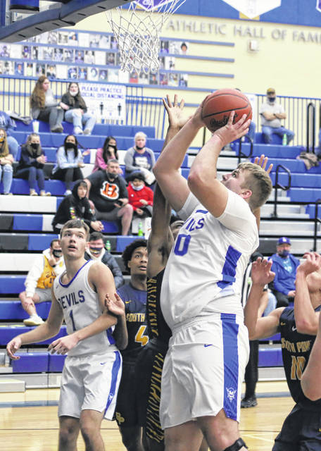 Gallia Academy sophomore Isaac Clary (50) releases a shot attempt over a South Point defender during the first half of Wednesday night's boys basketball contest against South Point in Centenary, Ohio.