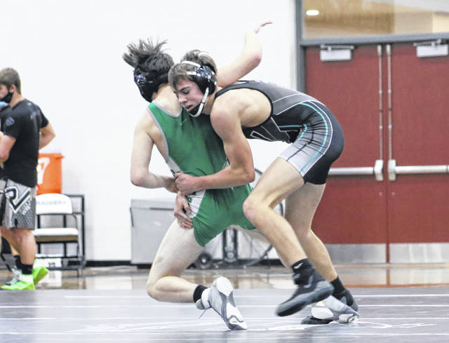 River Valley sophomore Justin Stump, right, takes an opponent down to the mat during a 138-pound match held Wednesday night at RVHS in Bidwell, Ohio.