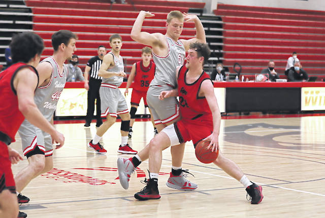 Rio Grande's Cam Schreiter drives toward the basket during the second half of last night's game against top-ranked Indiana Wesleyan at Luckey Arena in Marion, Ind. Schreiter scored a season-high 14 points in the RedStorm's 97-75 loss to the Wildcats.