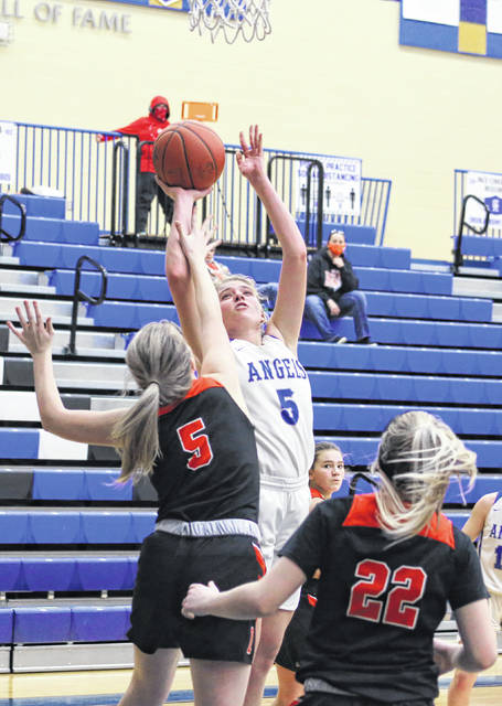 Gallia Academy senior Maddy Petro releases a shot attempt over an Ironton defender during a Jan. 7 girls basketball contest in Centenary, Ohio.