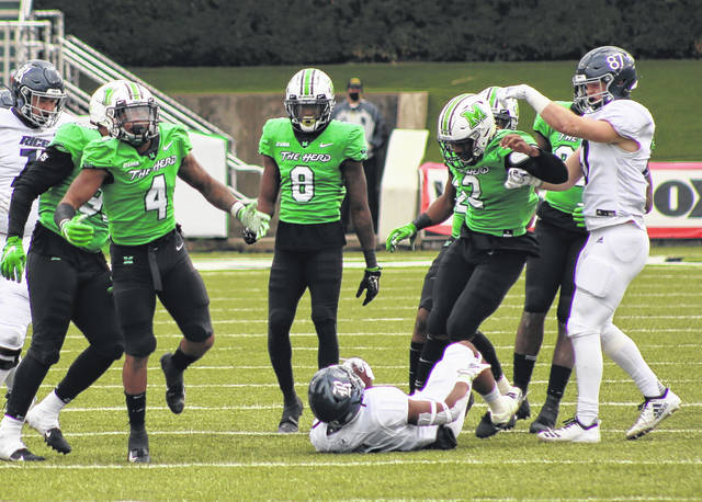 Marshall redshirt senior linebacker Tavante Beckett (4) celebrates after making a tackle against Rice in a Dec. 5, 2020, football contest in Huntington, W.Va.