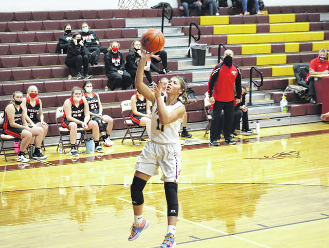 Meigs freshman Delana Wright (11) finishes a fast break with a layup, during the first half of the Lady Marauders loss to Alexander on Dec. 14 in Rocksprings, Ohio.