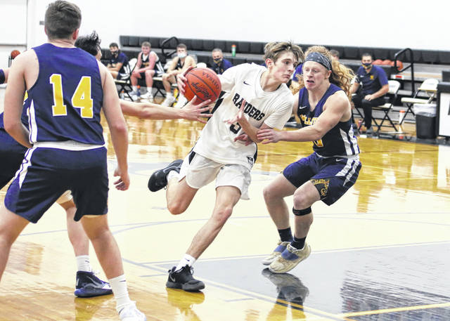 River Valley sophomore Jance Lambert dribbles through a pair of Wellston defenders during the second half of Tuesday night's boys basketball contest in Bidwell, Ohio.