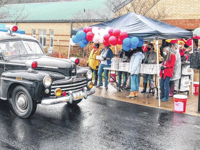 Veterans received donuts during this parade at Meigs Elementary last November and later that same day, free donuts were provided to senior citizens at a drive-thru event, which received funding from a Silver Lining Search grant applied for by teachers Megan McAllister and Penny Ramsburg. (Megan McAllister   Courtesy photo)