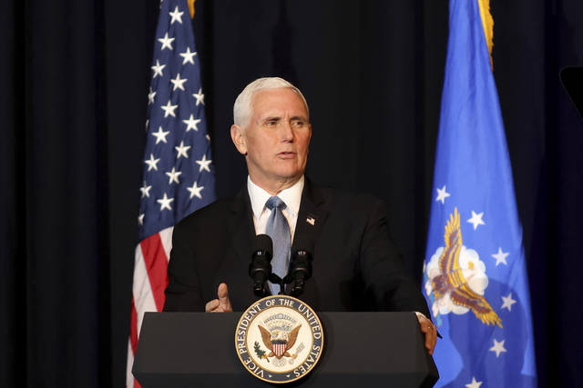 Vice President Mike Pence speaks during a memorial service for the late Air Force Brig. Gen. Chuck Yeager in Charleston, W.Va., on Friday, Jan. 15, 2021. Yeager died last month at age 97. The West Virginia native in 1947 became the first person to fly faster than sound. (AP Photo/Chris Jackson)