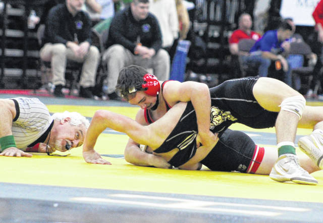 Point Pleasant's Derek Raike maintains leverage on an opponent during a 132-pound match at the 2020 WVSSAC Championships held in Huntington, W.Va.