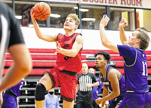 Rio Grande's Caleb Wallis drives the lane for two of his career-high 16 points in Saturday's 82-49 rout of Asbury University at the Newt Oliver Arena. The RedStorm won for a fifth straight time, while snapping the Eagles' seven-game win streak.