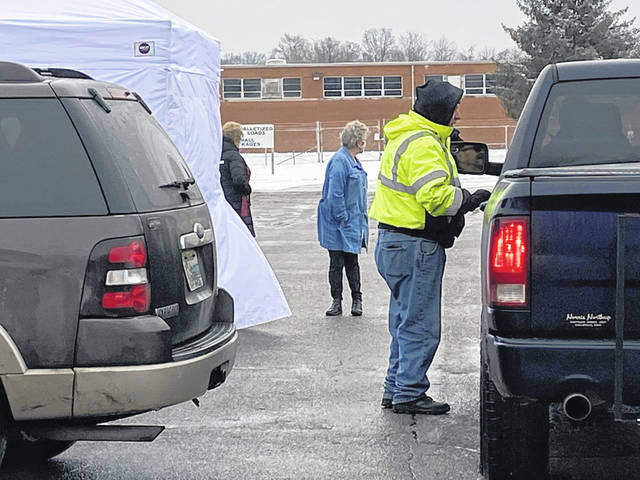 The weather didn't stop a planned COVID-19 vaccination clinic at the National Guard Armory in Mason County on Thursday. A coalition comprised of county agencies and the health care community has been working the clinics which are held as vaccines become available. This photo of residents arriving for vaccines provided by coalition member, Pleasant Valley Hospital. (PVH | Courtesy)