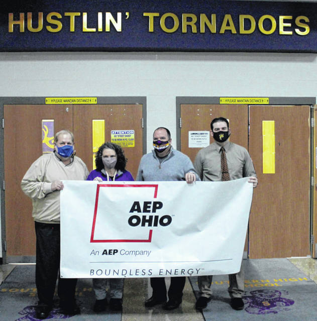 AEP recently made a $5,000 donation to the Southern Local School District's Athletic Department as part of a program to purchase AEDs for the school's gyms. This is part of larger plan to improve and maintain the athletic program which is somewhat crippled financially due to the pandemic. Pictured here holding the AEP banner are (from left) Scott Wolfe, Grants Administrator and Fundraising Organizer; Tricia McNickle, Elementary Principal; Tony Deem, Superintendent;and Daniel Otto, High School Principal. As one of the largest electric energy companies in the U.S., AEP powers millions of homes and businesses, as well providing energy to Racine and Southern Local. Together, with its customers, AEP is redefining the future of energy and developing innovative solutions that power communities and improve lives. Because of the COVID-19 pandemic, crowds at sporting events have been limited to parents, thus gate receipts have been practically non-existent and over time will put the athletic program in a financial bind. Southern wishes to thank the folks at AEP for their generous donation. Part of the fundraising plan includes getting AED defibrillators for all of the athletic facilities at Southern. Donations are still being sought as part of the athletic department campaign at Southern Local Athletics Donations, Attn: Scott Wolfe; 920 Elm Street, Racine, Ohio 45771. No donation is too small.