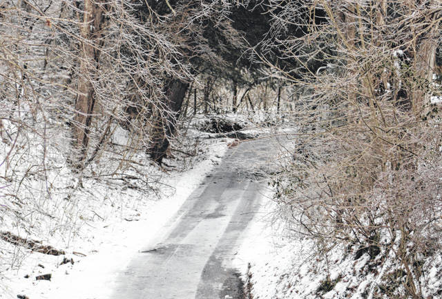 """Ice, snow and freezing temperatures made travel treacherous and caused power outages for some across the area on Tuesday. Meigs, Mason and Gallia counties are also expected to be under a new """"winter storm watch"""" from 7 p.m. on Wednesday (today) to 7 a.m. on Friday. (Sarah Hawley 
