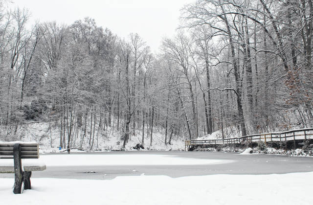 Snow and ice coated the Beech Grove Cemetery Pond on Mulberry Avenue in Pomeroy on Thursday.