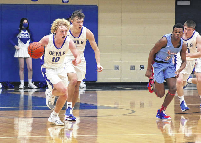 Gallia Academy sophomore Brody Fellure (10) leads a fast break during the first half of Friday night's boys basketball contest against Portsmouth in Centenary, Ohio.