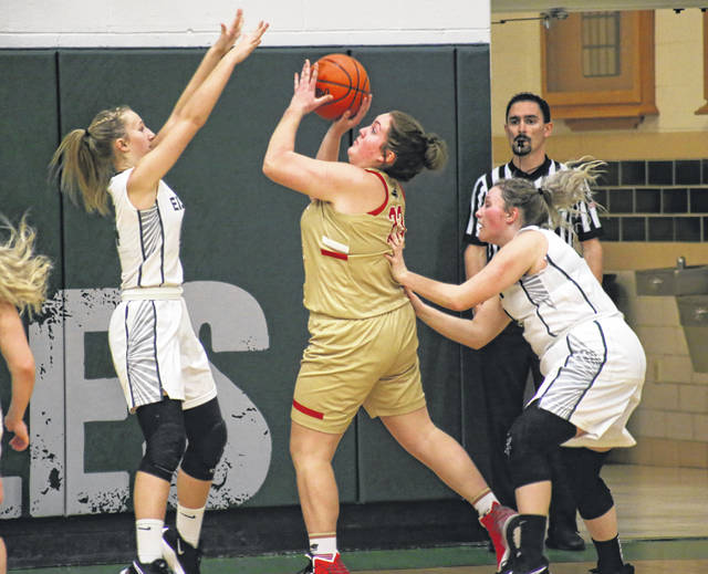SGHS senior Ryleigh Halley (center) shoots a two-pointer between Lady Eagles Sydney Reynolds (left) and Ella Carleton (right), during a TVC Hocking bout on Jan. 4 in Tuppers Plains, Ohio.