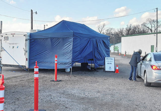 A nurse from the Meigs County Health Department administers a vaccine during a recent drive-through clinic at the Meigs County Fairgrounds.