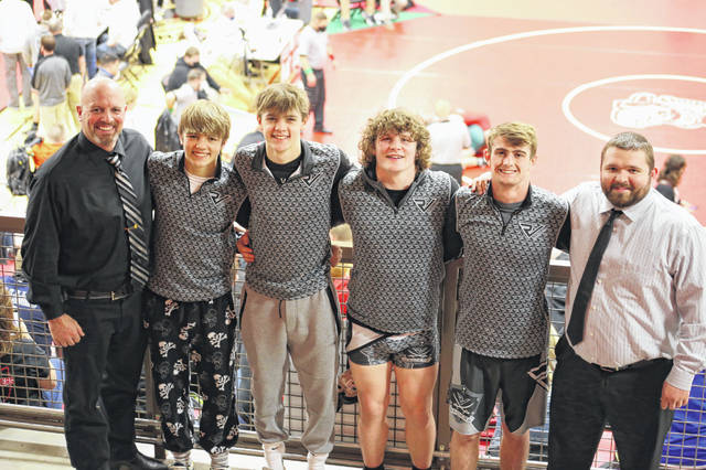 Members of the River Valley wrestling team pose for a picture atop the bleachers at Marion High School on Saturday at the 2021 OHSAA Division III championships held in Marion, Ohio. Standing, from left, are RVHS coach Matthew Huck, Andrew Huck, Justin Stump, Will Hash, Nathan Cadle and RVHS assistant coach Mark Allen.