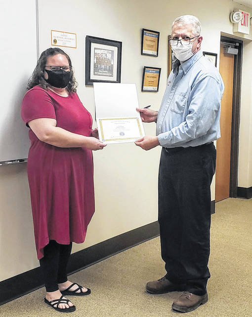 Pictured at left is<em> The Daily Sentinel</em> Managing Editor Sarah Hawley being recognized by Meigs Local School Board President Ryan Mahr, after the Board named her to the Ohio School Boards Association 2020 Media Honor Roll. (Meigs Local | Courtesy)