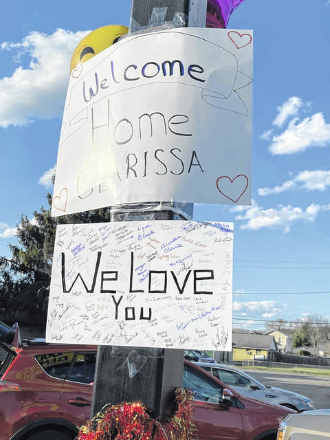 Signs hung from telephone poles, businesses, and yards to welcome Clarissa Marr home from the hospital, and to tell her how much she is loved.