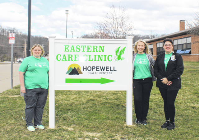 Tara Vogt, Samantha Marty and Amber Johnson of Hopewell's Eastern Care Clinic are picture by the clinic sign.