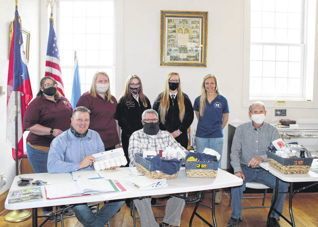 Meigs County Commissioners Jimmy Will, Shannon Miller and Tim Ihle are pictured with Athens-Meigs Farm Bureau and Meigs FFA representatives Jennifer Dunn, Hannah Thompson, Shelby Cochran, Meredith Cremeans and Alyssa Webb.