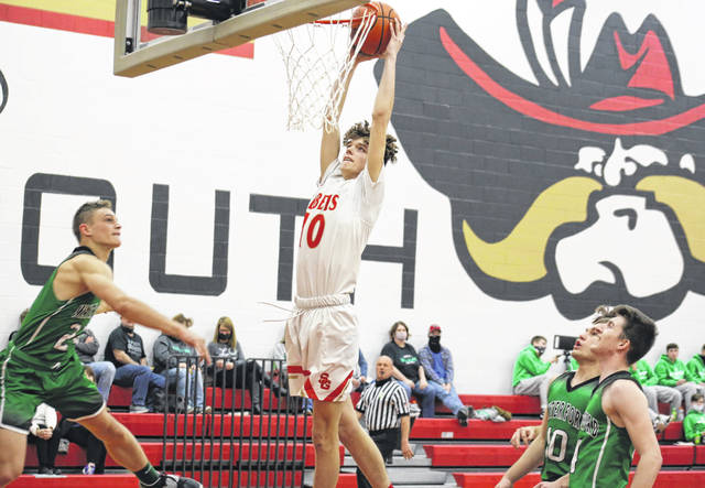 South Gallia senior Jaxxin Mabe (center) slams down a dunk in between a trio of Wildcats, during Waterford's three-point win on Thursday in Mercerville, Ohio.