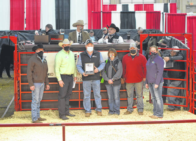 The AMW Cattlemen's Association received the Friends of the Expo award. Pictured from left, J.L. Draganic, Expo co-chair; Aaron Arnett, OCA Board president; Jeff and Stephanie Cox, AMW Cattlemen's Association members; David Marcum, AMW Cattlemen's Association member; Pam Haley, Expo co-chair. (Courtesy)