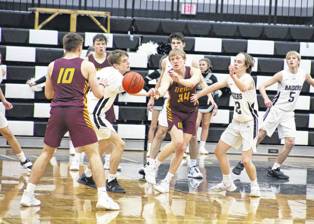 Meigs junior Morgan Roberts (34) fires a pass out to Coulter Cleland during the second half of Game 2 on Tuesday night in a TVC Ohio matchup against River Valley in Bidwell, Ohio.