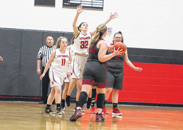 Point Pleasant sophomore Patience Burke (32) applies pressure to a Nitro player during the second half of Tuesday night's girls basketball contest in Point Pleasant, W.Va.