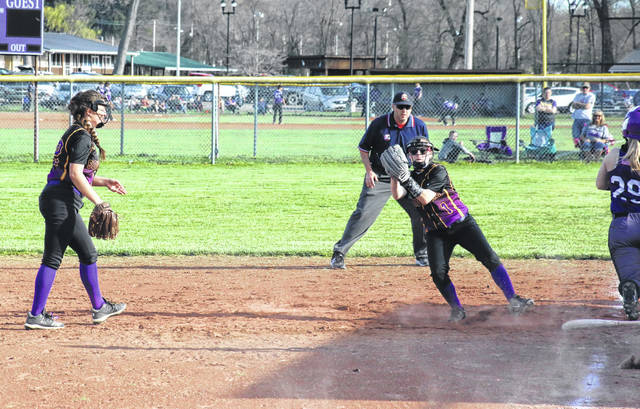 SHS first baseman Lily Allen (left) tosses to second baseman Brooke Crisp (1), for a force out at first, during the Lady Tornadoes' 5-3 win on Tuesday in Racine, Ohio.