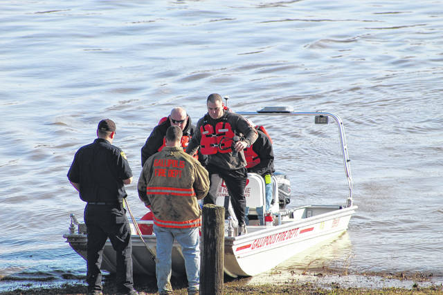 Firefighters from Point Pleasant and Gallipolis, along with law enforcement from Gallia and Mason counties, were part of a recovery effort on Friday after a woman reportedly jumped from the Silver Memorial Bridge. (Beth Sergent | OVP)